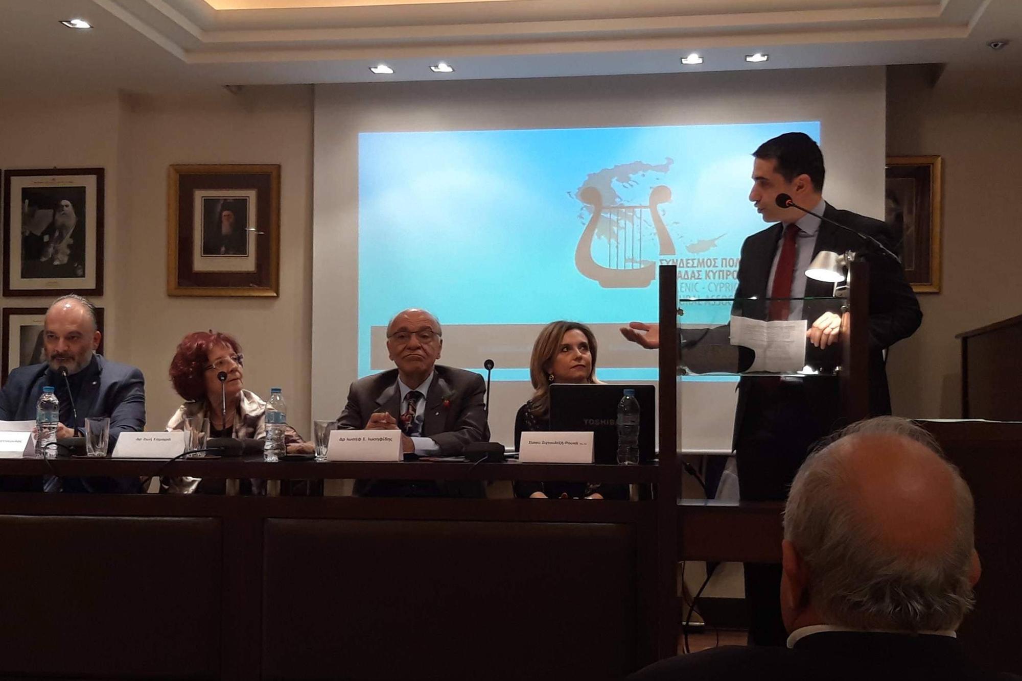 Ετήσιος Θεσμός Συνδέσμου Πολιτισμού Ελλάδας Κύπρου, «Βραβείο Λογοτέχνη για το Σύνολο του Έργου του 2019». Στη φωτογραφία ομιλεί στο βήμα ο Πρόξενος της Κυπριακής Δημοκρατίας στη Θεσσαλονίκη, κ. Σπύρος Μιλτιάδης, ενώ στο πάνελ διακρίνονται οι ιδρυτές του ΣΠΕΚ, κα Σίσσυ Σιγιουλτζή-Ρουκά (Πρόεδρος), ο Δρας Ιωσήφ Σ. Ιωσηφίδης (Αντιπρόεδρος) και τα Ιδρυτικά Μέλη, Ζωή Σαμαρά (Ομότιμη Καθηγήτρια Α.Π.Θ.) και Δρ Ανδρέας Σταματόπουλος (ιστορικός – εθνολόγος). Στην παρούσα εκδήλωση βραβεύτηκαν ισότιμα ο Κυριάκος Χαραλαμπίδης (Κύπρος) και η Μαρία Κέντρου-Αγαθοπούλου (Ελλάδα).